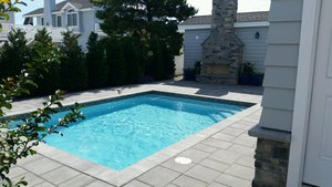 Concrete Residential Pool #052 by PM Pool And Spas