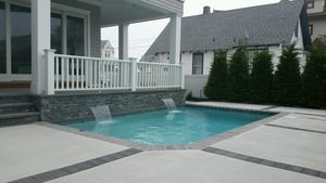 Concrete Residential Pool #056 by PM Pool And Spas